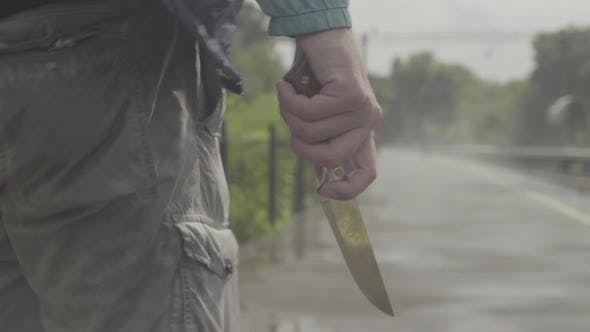 Maniac with a Knife Near the Railway Tracks.