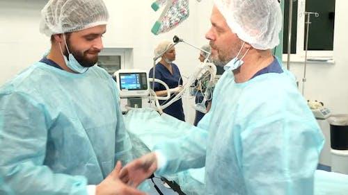 Surgeons Shake Their Hands