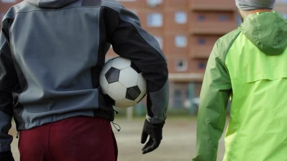 Thumbnail for Two Soccer Players Walking on Outdoor Field with Ball