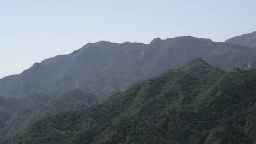 Panning shot of the mountains near the Great Wall of China at Badaling.