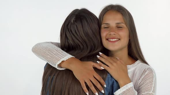 Thumbnail for Lovely Young Woman Smiling with Eyes Closed, Embracing Her Best Friend