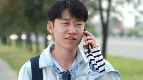 Thumbnail for Asian Teenager Talking on Cell Phone
