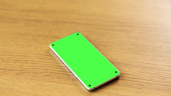 Thumbnail for Smartphone with Blank Green Screen on Wooden Table