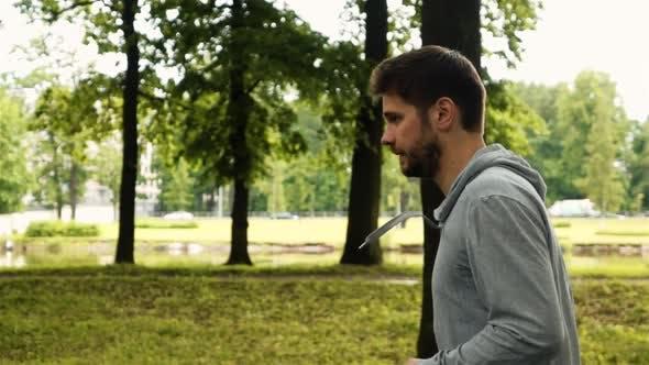 Thumbnail for Man Running at the Green Summer Park