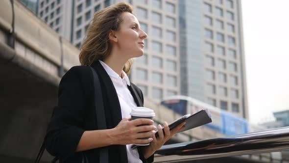 Thumbnail for Business Woman With Tablet On City Background