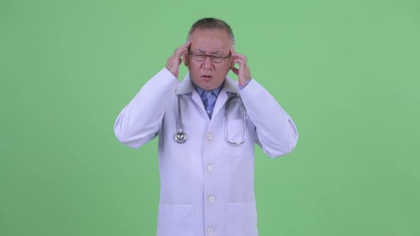 Thumbnail for Stressed Mature Japanese Man Doctor Having Headache