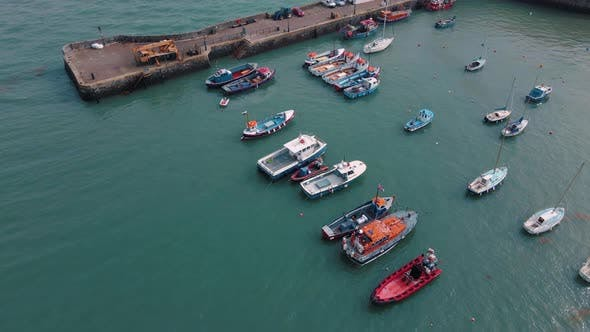 A Flight over Boats in a Harbour