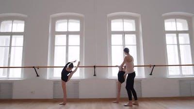 Ballet Teacher Working with Two Ballerinas