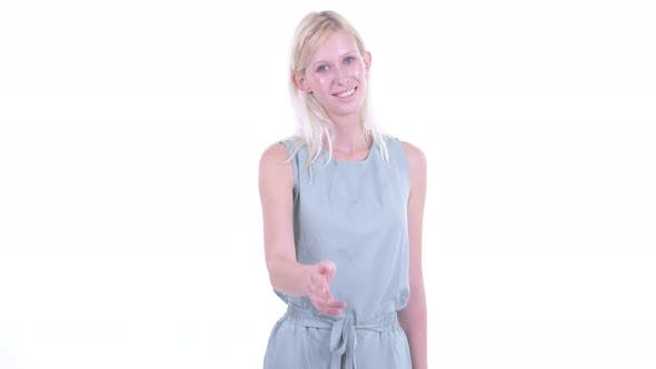 Cover Image for Happy Young Beautiful Blonde Woman Giving Handshake