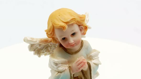 Thumbnail for Beautiful Little Angel Statuette on a White Background
