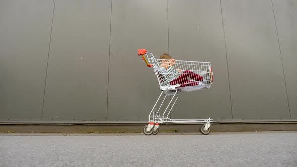 Thumbnail for Shopping Background. Shopping Cart with Child Inside
