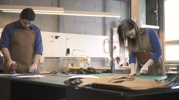 Thumbnail for Male and Female Masters Making Bag Details with Artificial Leather