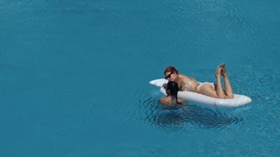 Beautiful Girlfriends Having Fun in Swimming Pool