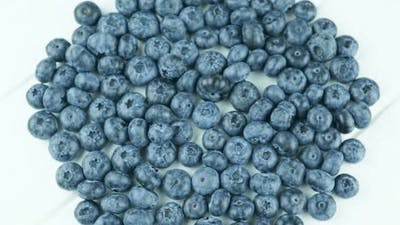 Fast Rotation Of Juicy Blueberries On A White Background.