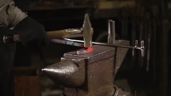 Thumbnail for Blacksmith Is Beating Over Warmed Metal Billet on an Anvil in Forge