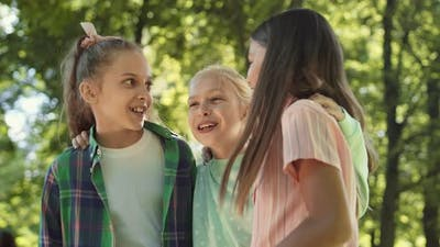 School Girlfriends Gossiping Outdoors