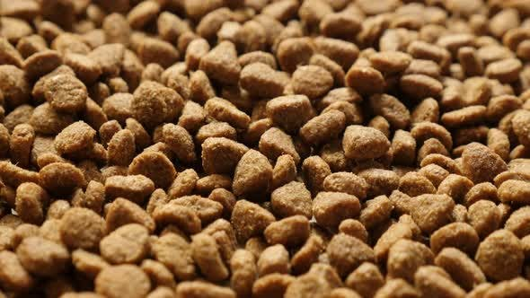 Thumbnail for Pile of pet dry food slow tilt 4K 2160p 30fps UltraHD footage - Extruded pellet meal for domestic an