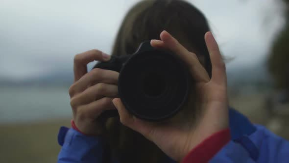Thumbnail for Woman Reporter Taking Photo on Beach in Cold Weather, Camera Lens Close Up