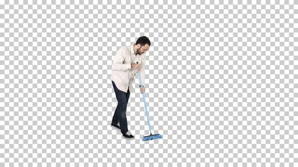 Thumbnail for Young man cleaning floor with brush, Alpha Channel