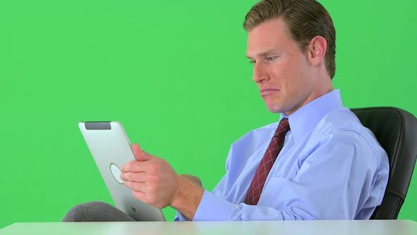 Thumbnail for businessman working on his tablet on greenscreen