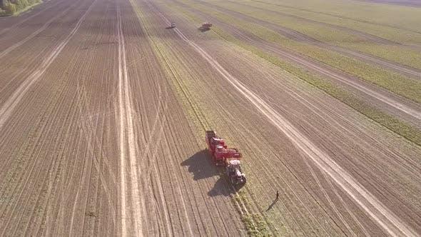 Thumbnail for Flight Around Potato Harvester on Field on Sunny Day