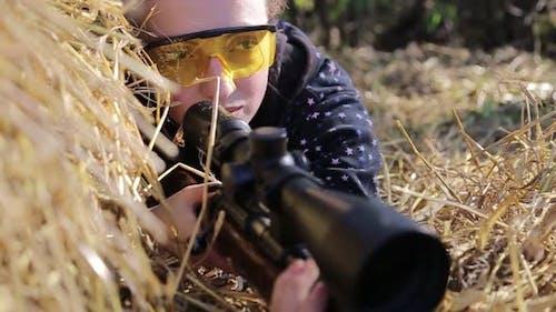 Woman Duck Hunter Wearing Camo Waders with Rifle