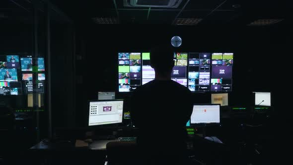 Cover Image for Man Manages the Broadcast in TV Control Room