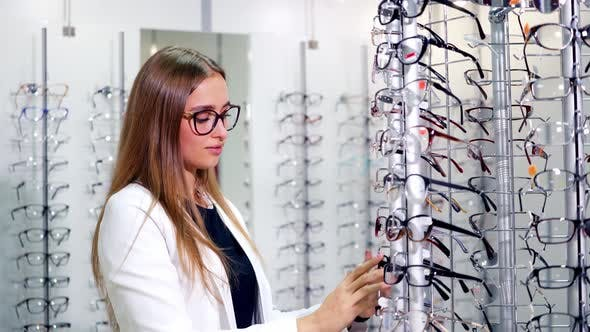 Thumbnail for Woman trying on eyeglasses. Portrait of woman in optical shop trying eyeglasses