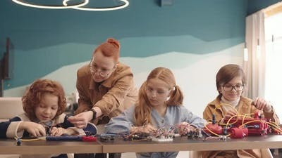 Teacher and Pupils Constructing Robots