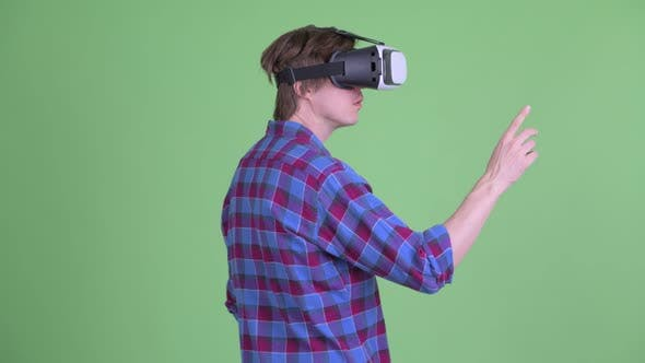 Thumbnail for Rear View of Young Hipster Man Using Virtual Reality Headset