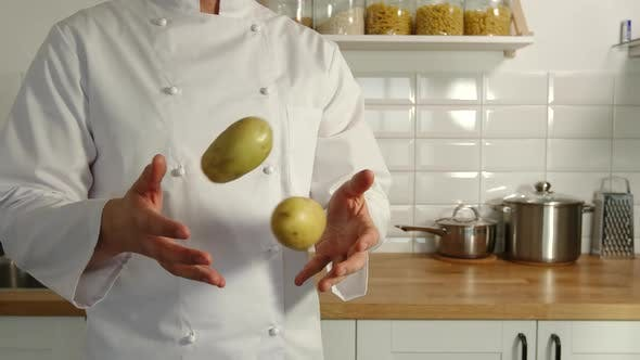 Thumbnail for Chief-Cooker Juggles A Potatoes In A Kitchen
