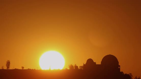 Thumbnail for Time lapse of the sun rising from behind the Griffith Observatory