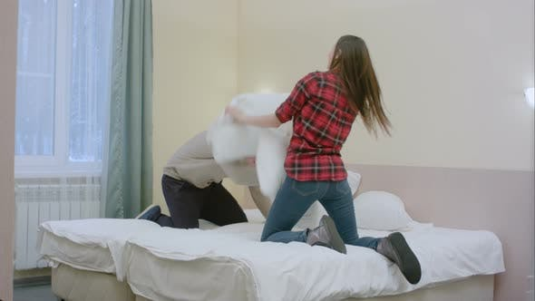 Thumbnail for Sexy Couple Enjoying Their Pillow Fight Game in Bed in a Hotel Room