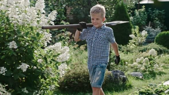 Thumbnail for Boy with Shovel in Garden