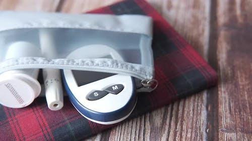 Close Up of Diabetic Measurement Tools in Small Bag