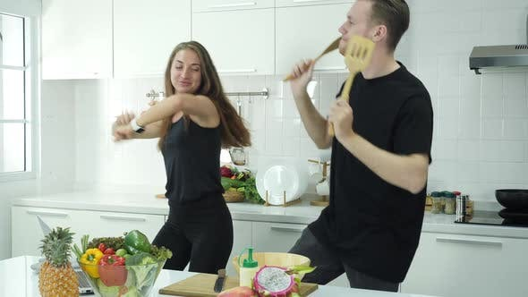 Happy dancing in kitchen