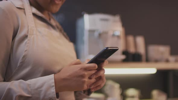 Thumbnail for Waitress Texting Messages And Smiling
