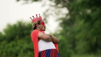 Hero man in red with crown standing and cool pose