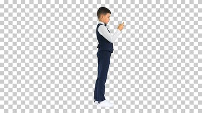 Concentrated boy in waistcoat using voice, Alpha Channel
