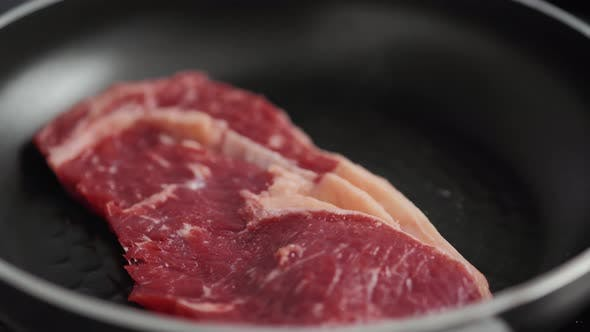 Cooking Rib Eye Steak with Herbs on Grill Pan Close Up Macro Pan Fresh