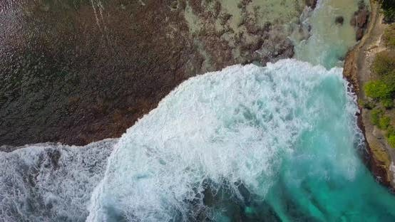 Thumbnail for Aerial drone view of a coral reef and waves at the beach.