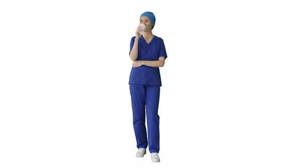 Cover Image for Smiling Female Doctor or Nurse in Blue Uniform Having a Coffee Break on White Background.