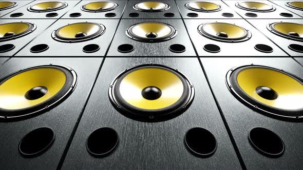 Cover Image for Static View of Audio Speakers with Yellow Membranes Stacked in Rows Playing Club Music