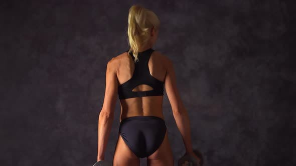 Thumbnail for Rear view of blonde woman training