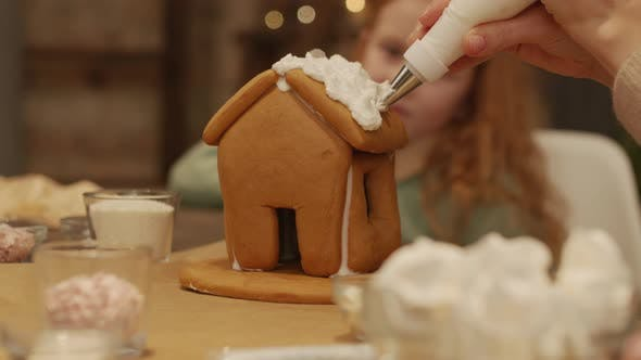Thumbnail for Homemade Gingerbread House Decorated With Cream