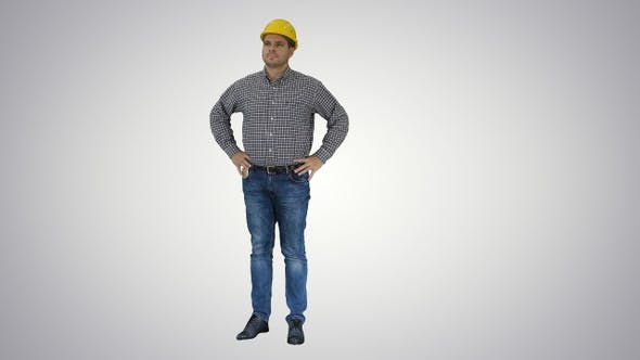 Thumbnail for Smiling Construction Worker in Yellow Helmet Looking At