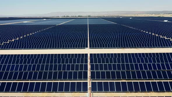 Thumbnail for Drone Is Flying Straight Forward Above the Graphic Rows of Solar Power Fields