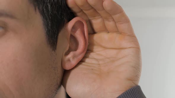 Thumbnail for Man Puts His Palm To His Ear To Hear Better