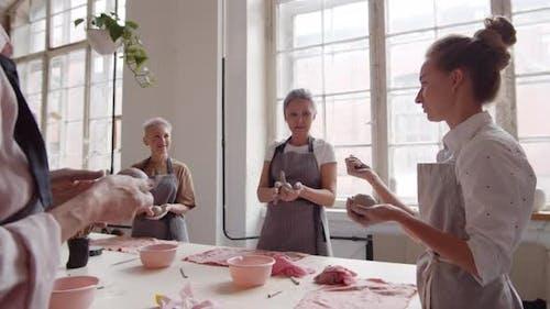Tutor at Ceramic Lesson in Workshop