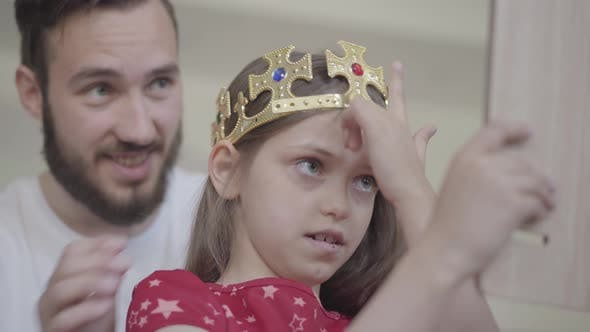 Thumbnail for Portrait Attractive Young Bearded Father Putting the Crown on the Head of His Little Girl, Making
